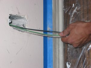 electrician pulling wires in beverly hills home