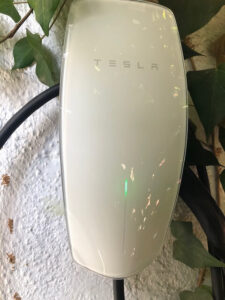tesla charger installed on outside wall